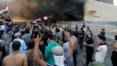 Iraqi police open fire, use tear gas and water cannon to disperse Baghdad protests